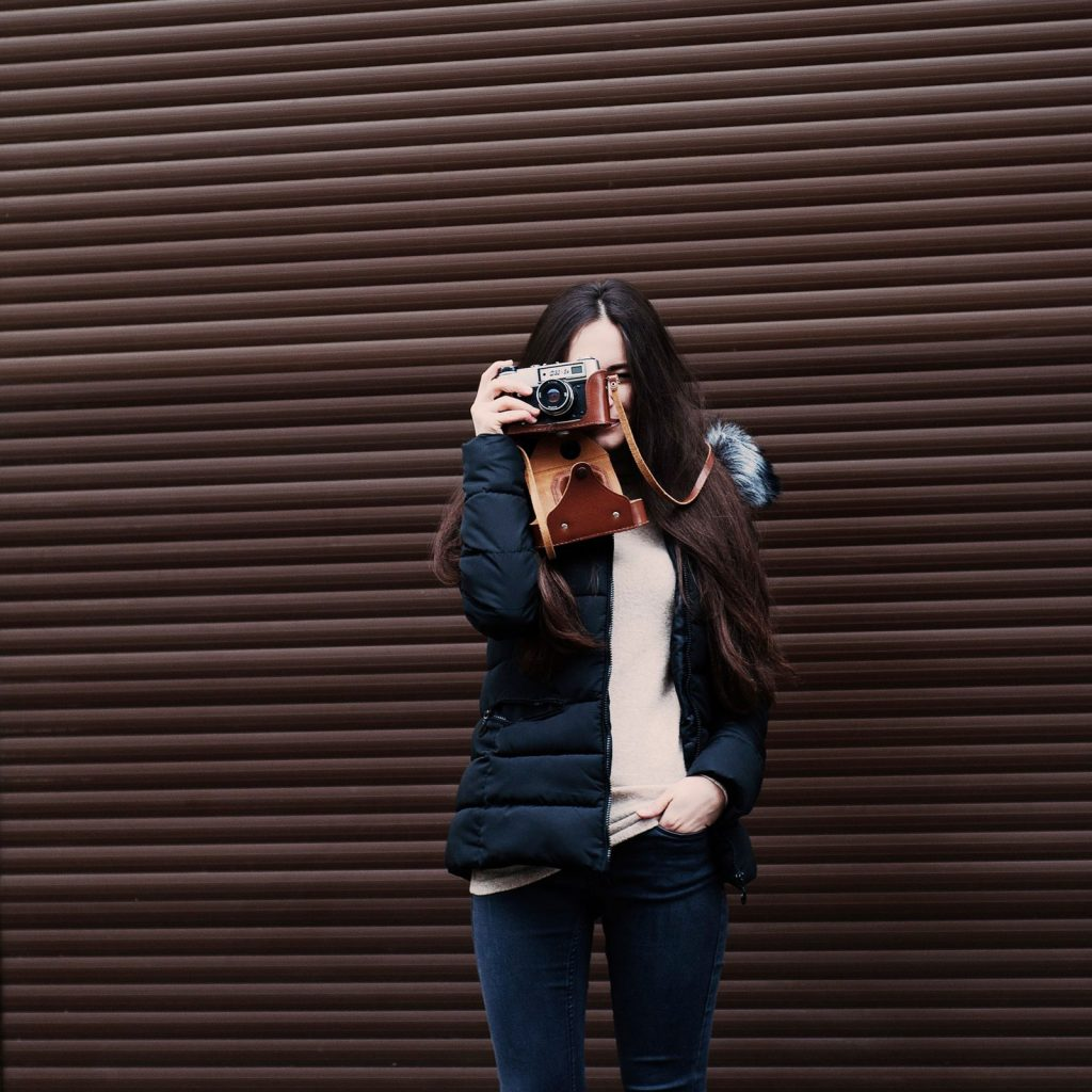 young woman-camera-taking picture
